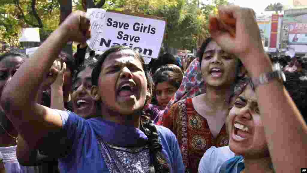 Indian students shout slogans during a protest rally in Hyderabad, India, December 31, 2012.