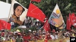 Venezuelans rally along a Caracas street