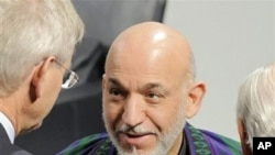 Afghan President Hamid Karzai talks with delegates during the International Conference on Security Policy in Munich, southern Germany, February 6, 2011.