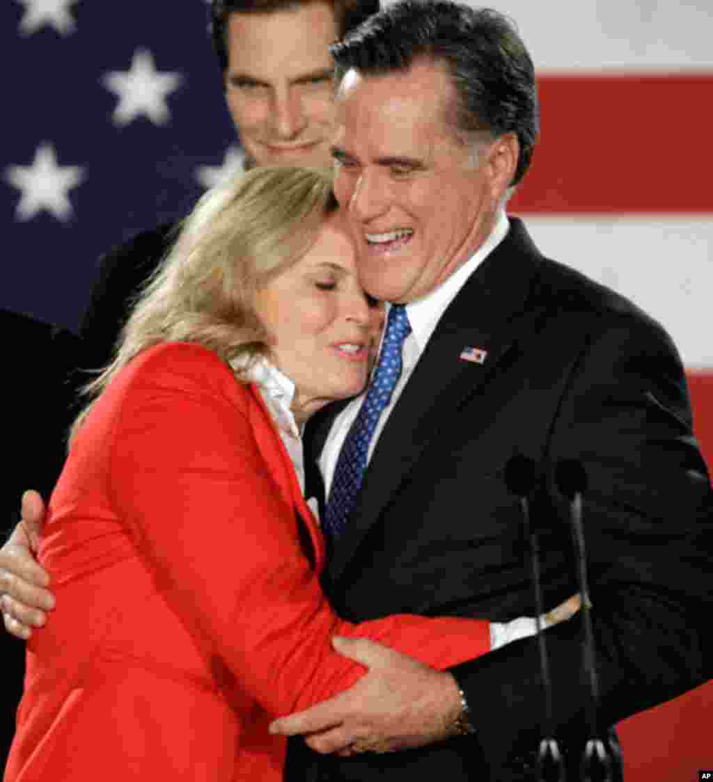 Republican presidential candidate Mitt Romney hugs his wife Ann during a Caucus night rally in Des Moines, Iowa, Tuesday, Jan. 3, 2012. (AP)