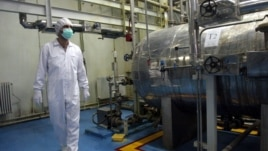 FILE - In this Feb. 2007 photo, an Iranian technician walks through the Uranium Conversion Facility just outside the city of Isfahan 410 kilometers (255 miles) south of the capital, Tehran.