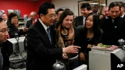 FILE - Chinese President Hu Jintao visits the Confucius Institute at Walter Payton College Preparatory High School in Chicago, Jan. 21, 2011.