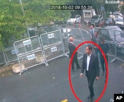 In a frame from surveillance camera footage taken Oct. 2, 2018, and published Oct. 18, 2018, by Turkish newspaper Sabah, a man identified by Turkish officials as Maher Abdulaziz Mutreb, walks toward the Saudi consulate in Istanbul.