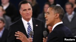 U.S. President Barack Obama (R) speaks as Republican presidential nominee Mitt Romney (L) listens during the second U.S. presidential debate in Hempstead, New York, October 16, 2012.