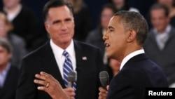U.S. President Barack Obama (R) speaks as Republican presidential nominee Mitt Romney (L) listens during the second U.S. presidential debate in Hempstead, New York, October 16, 2012.