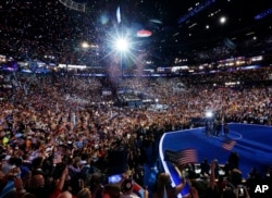FILE - President Barack Obama, first lady Michelle Obama, their children Malia and Sasha, and Vice President Joe Biden and his wife Jill Biden, wave on stage on the final day of the Democratic National Convention in Charlotte, N.C., Sept. 6, 2012.