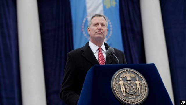 New York City Mayor Bill de Blasio speaks after being sworn in during the public inauguration ceremony at City Hall in New York, Jan. 1, 2014.