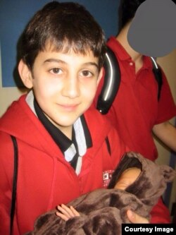 Dzhokhar Tsarnaev, shown in January 2007, holding the daughter of his grade school teacher