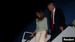 U.S. President Donald Trump and first lady Melania Trump arrive aboard Air Force One at the end of his first international trip as president, to Joint Base Andrews, Maryland, May 27, 2017.