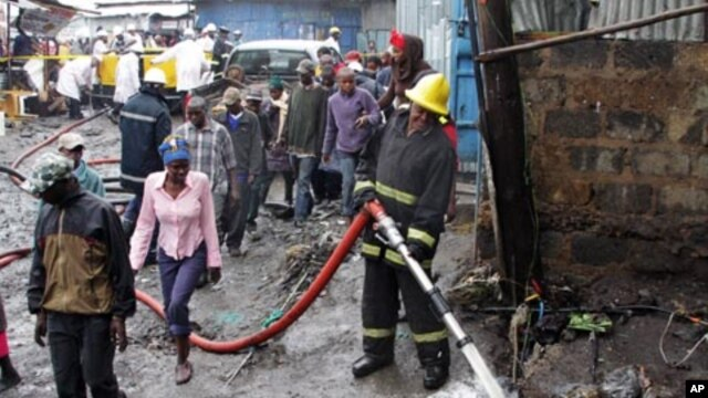 Rescuers at the scene of the pipeline explosion in Nairobi's Mukuru Sinai slums on Sept. 12, 2011.