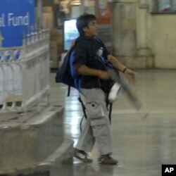 Pakistani Mohammed Ajmal Kasab walks in the Chatrapathi Sivaji Terminal railway station during the 2008 attacks in Mumbai. Kasab, the only surviving gunman, was convicted this month by an Indian court.