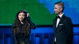 Lorde is accompanied by producer Joel Little after they won the award for Song of the Year for