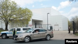 FILE - A sheriff's car leaves Paisley Park, U.S. music superstar Prince's estate in Chanhassen, Minn., April 21, 2016. The administrator of Prince's estate says it is not planning to sell Paisley Park, one day after asking a judge for permission to offer