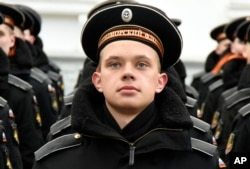 FILE - Russian Black Sea fleet sailors take part in a military parade in Sevastopol, Crimea, on March 18, 2015.
