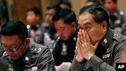 Kepala polisi nasional Thailand, Jenderal Somyot Poompanmoung, dalam rapat terkait anti perdagangan manes di marks besar polisi di Bangkok, Thailand (8/5).