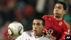 El Zamalek's Mohamed Abdel-Shafy (L) fights for the ball with Al-Ahly's Ahmed Fathy during their Egyptian Premier League derby soccer match at Cairo Stadium, (File)