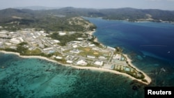FILE - Coral reefs are seen along the coast near the U.S. Marine base Camp Schwab, off the tiny hamlet of Henoko in Nago on the southern Japanese island of Okinawa, in this aerial photo taken by Kyodo, Oct. 29, 2015.