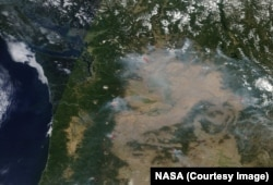 NASA's Terra satellite shows a blanket of smoke from several raging fires in western and central Washington state, Aug. 17.