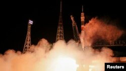 The Soyuz TMA-15M spacecraft carrying the International Space Station crew of Anton Shkaplerov of Russia, Terry Virts of the U.S. and Samantha Cristoforetti of Italy blasts off from the launch pad at the Baikonur cosmodrome, November 24, 2014.