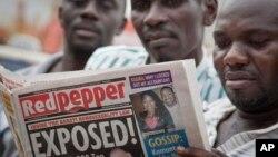 "A Ugandan reads a copy of the ""Red Pepper"" tabloid newspaper in Kampala, Uganda, Feb. 25, 2014."