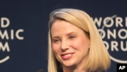 FILE - Yahoo CEO Marissa Mayer smiles during a session at the World Economic Forum in Davos, Switzerland.