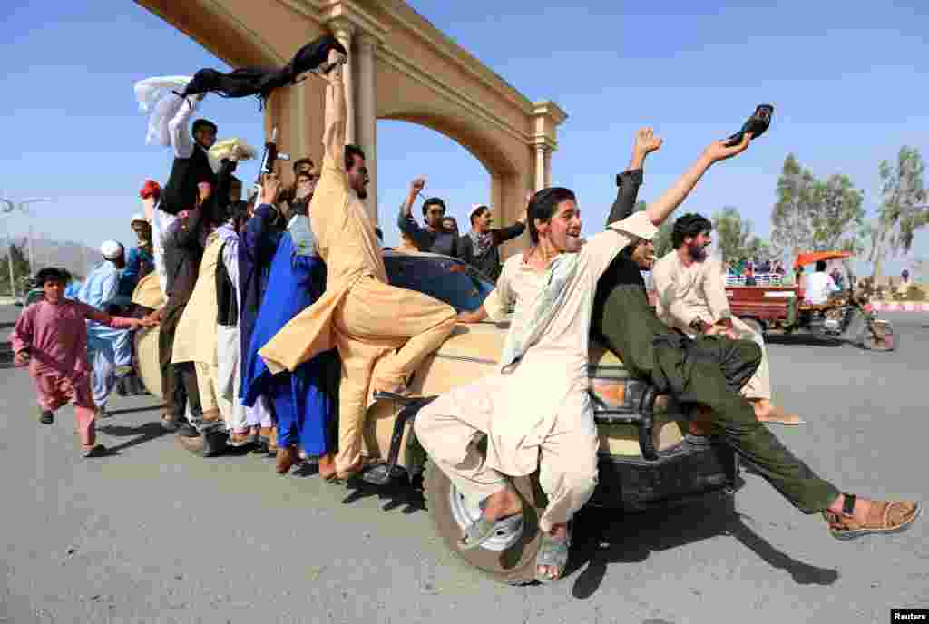 People celebrate ceasefire in Rodat district of Nangarhar province, Afghanistan.