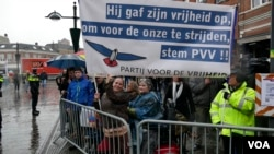 "Rally participant Susan Pfaff-Bons created a banner reading ""He gave up his freedom to fight for ours. Vote Freedom Party,"" in Breda, Netherlands, March 2017. (M. van der Wolf/VOA)"