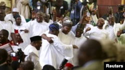 Members of the House of Representatives are seen celebrating after Rt. Hon Yakubu Dogara was sworn in as the new Speaker of the House of Representatives in Abuja, Nigeria, June 9, 2015. REUTERS/Afolabi Sotunde - RTX1FUGZ