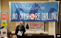 Crystal Dingler, the mayor of Ocean Shores, Wash., speaks at a hearing in Olympia, Wash., organized by a coalition of environmental groups opposed to the Trump administration's proposal to expand offshore oil drilling off the Pacific Northwest coast, March 5, 2018.