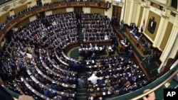 FILE - Members of Egypt's Parliament attend the inaugural session, the first to convene in three years, in Cairo.