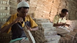 Men prepare bars of salt to be sold in the main market of the city of Mekele, northern Ethiopia, in this April 24, 2013, file photo.