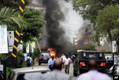 Fire and smoke rises from an explosion in Nairobi, Kenya, Jan. 15, 2019. An upscale hotel complex in Kenya's capital came under attack with a blast and heavy gunfire.