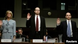 From left, former JPMorgan Chase executives Ina Drew and Peter Weiland, and the company's Acting Chief Risk Officer, Ashley Bacon, testify before Senate Homeland Security Investigations Subcommittee, Washington, March 15, 2013.