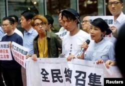 Pro-democracy legislator Claudia Mo speaks during a protest outside the Legislative Council building in Hong Kong, June 11, 2019.
