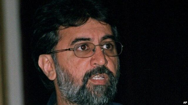 FILE - Tarun Tejpal, editor in chief Tehelka.com, talks to the media, Mar. 13, 2001.