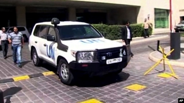 Image taken from AP Television shows a UN vehicle leaving the Four Seasons Hotel in Damascus, Syria, Aug. 27, 2013.