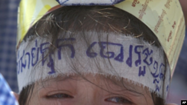 Poa Sokun Kanha, 11, from Boueng Kak cries as she joins a rally to ask King Norodom Sihamoni to help release of villagers, in front of Royal Palace in Phnom Penh, Thursday, May 31, 2012. The villagers were arrested when they tried to rebuild their homes o