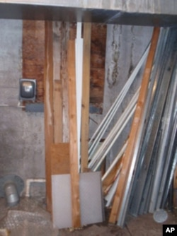 The horizontal wood slats in this utility room cover up a long unused tunnel that's thought to lead to an adjacent building.
