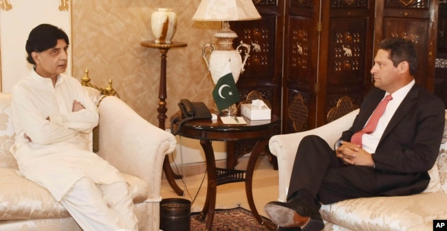 In this photo released by Pakistan's Press Information Department, July 7, 2017, Pakistani Interior Minister Chaudhry Nisar Ali Khan, left, meets Vice President of Facebook Joel Kaplan in Islamabad, Pakistan.