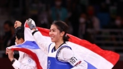 Tokyo 2020 Olympics - Taekwondo - Women's Flyweight - 49kg - Gold medal match - Makuhari Messe Hall A, Chiba, Japan - July 24, 2021. Panipak Wongphatthanakit of Thailand celebrates winning gold with the Thai national flag REUTERS/Murad Sezer