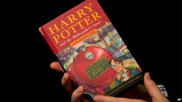"FILE - A photo of the first edition copy of the first Harry Potter book ""Harry Potter and the Philosopher's Stone"" by author J.K. Rowling taken at Sotheby's in London on May 20, 2013."