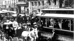 Horse-drawn wagons and electric trolley cars share the streets in 1897 Philadelphia during a time of revolutionary change in transportation and industry