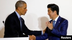 U.S. President Barack Obama shakes hands with Japan's Prime Minister Shinzo Abe after a bilateral meeting during the 2016 Ise-Shima G7 Summit in Shima, Japan, May 25, 2016.
