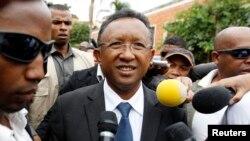 FILE - Madagascar's presidential candidate Hery Rajaonarimampianina arrives to cast his ballot at a polling centre in Tsimbazaza area of Madagascar's capital Antananarivo, Dec. 20, 2013.