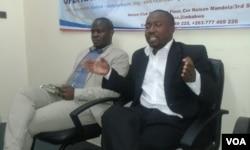 MDC spokesperson Jacob Mafume and Promise Mkhwananzi of the Zimbabwe National Informal Economy Network.