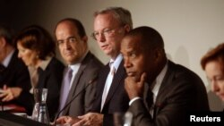 Google Executive Chairman Eric Schmidt, center, joins panelists hearing privacy and public information concerns in Madrid Sept. 9, 2014.