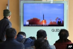 FILE - People watch a TV screen showing file footage of North Korea's missile launch at Seoul Railway Station in Seoul, South Korea, Nov. 21, 2017.