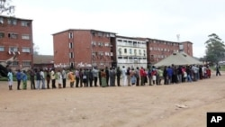 Voters captured in one of the polling stations in Zimbabwe's capital city, Harare. (AP)
