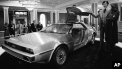John Z. DeLorean and his wife Christina with the DeLorean model 12 prototype car as it was unveiled in New Orleans, La., Jan. 31, 1977.