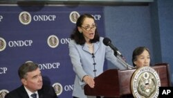 Food and Drug Administration (FDA) Commissioner Margaret Hamburg, center, accompanied by Office of National Drug Control Policy Director Gil Kerlikowske, left, and Health and Human Services Assistant Secretary Howard Koh, speaks during a news conference